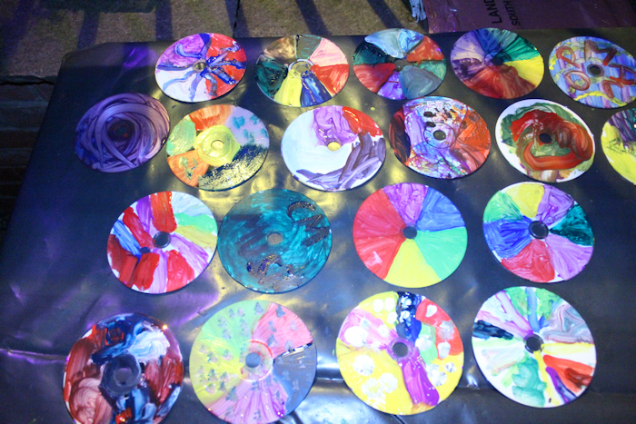 A small selection of CDs painted as part of the community sculpture public interaction event held by artist Laury Dizengremel during the finale evening of the Gravity Fields Festival