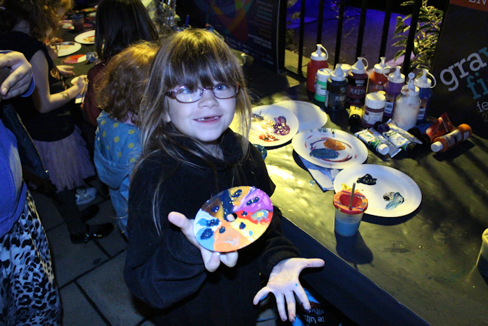 One proud kid shows her take on Isaac Newton's colour wheel painted onto a recycled CD