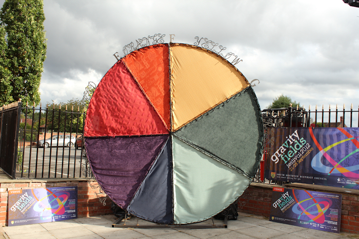 Daytime view of Isaac Newton Colour Circle - an artwork in steel and fabric by sculptor Laury Dizengremel