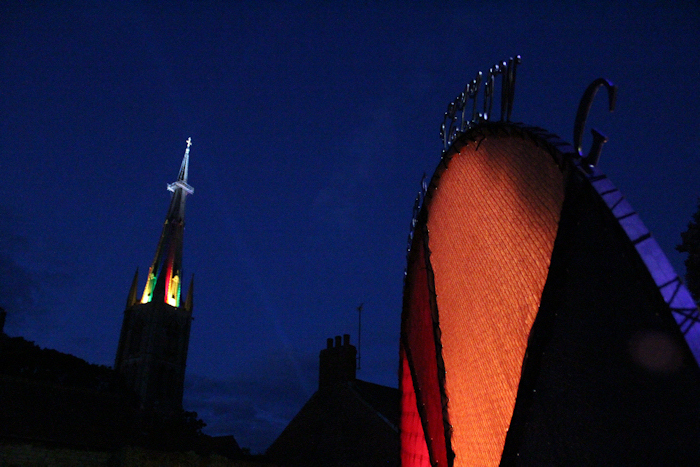 St Wulframs Church and its magic lightshow highlighted against the sky near Isaac Newton Colour Circle artwork installation