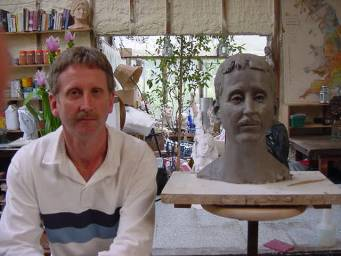 Mr. Paul Morgan with his completed bust in clay