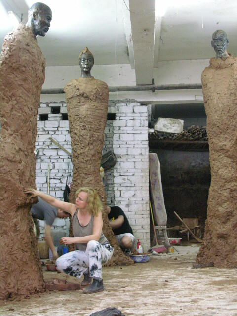 Working details on one of the monumental Artists of the Silk Road sculptures in clay