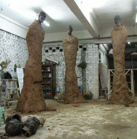 A view of all 3 monumental statues in clay in the Chinese sculpture studio