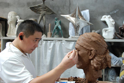 Sculptor Shen Xiaonan working on Rafael Nadal's bust in clay - to be cast in resin later and mounted onto its own Tennis Terracotta Warrior body