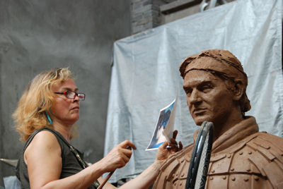 Award-winning sculptor Laury Dizengremel at work on one of her figurative sculptures - a Tennis Terracotta Warrior for the ATP and Master Cup Shanghai